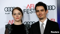 "Director Damien Chazelle and cast member Emma Stone pose at the premiere of ""La La Land"" during AFI FEST in Hollywood, Calif., Nov. 15, 2016."