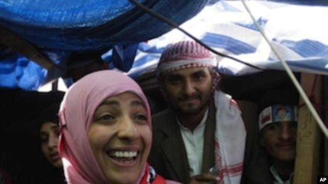 Yemeni activist Tawakkul Karman, one of the three recipients of the 2011 Nobel Peace Prize, reacts as she receives congratulations from protestors at her tent in Change Square in Sanaa, Yemen, Saturday, Oct. 8, 2011.