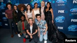 "Finalists (L-R standing) Trent Harmon, Avalon Young, La'Porsha Renae, Gianna Isabella, Tristan McIntosh, Olivia Rox, Sonika Vaid, (L-R front) Lee Jean, Dalton Rapattoni and MacKenzie Bourg pose at the party for the finalists of ""American Idol XV"" in West Hollywood, California, Feb. 25, 2016."