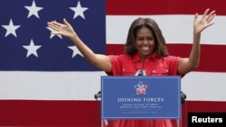 U.S. first lady Michelle Obama gestures during her visit to the U.S. Army Garrison at Vicenza, northern Italy, June 19, 2015.