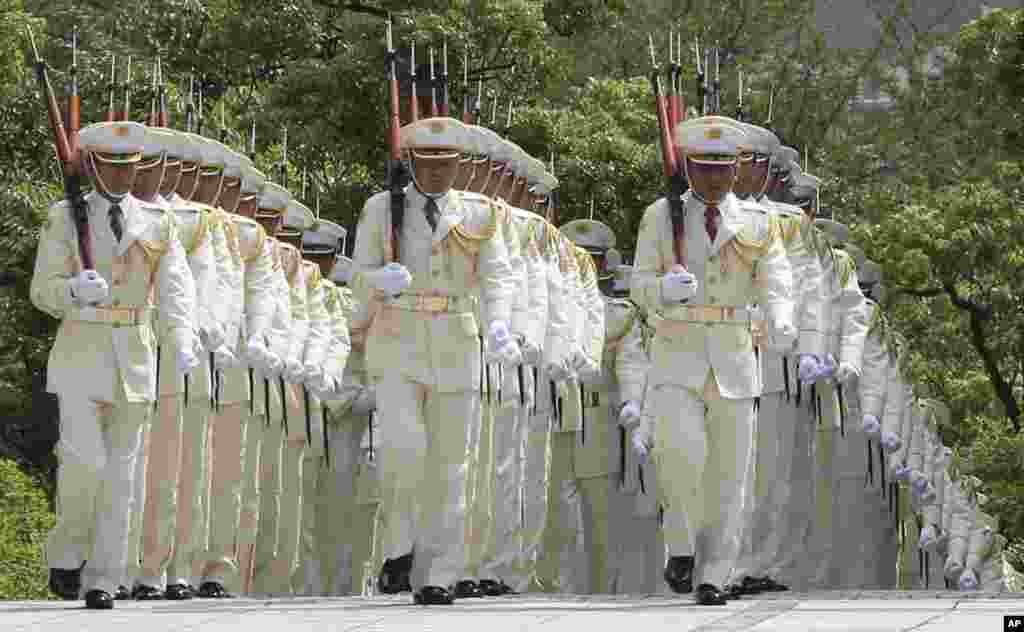 Members of an honor guard march during a preparation before Japanese Prime Minister Shinzo Abe reviews them in a ceremony prior to his meeting with high-ranked officers of the Japan Self-Defense Forces at the Defense Ministry in Tokyo.