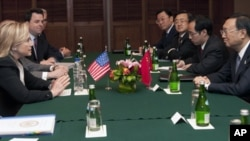 Secretary of State Hillary Rodham Clinton, left, attends a meeting with Chinese Foreign Minister Yang Jiechi, right, on the sidelines of the Association of Southeast Asian Nations Ministerial Meeting in Nusa Dua, Indonesia Friday, July 22, 2011.