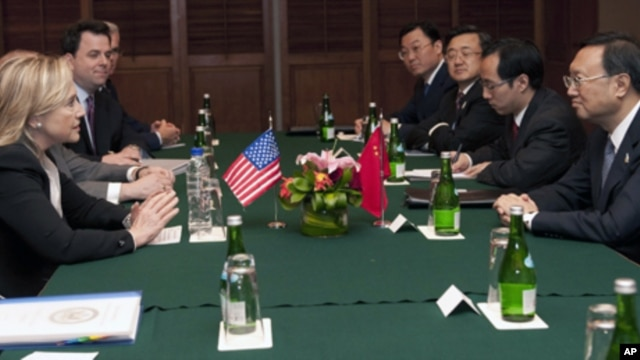 U.S. Secretary of State Hillary Rodham Clinton, left, attends a meeting with Chinese Foreign Minister Yang Jiechi, right, on the sidelines of the Association of Southeast Asian Nations (ASEAN) Ministerial Meeting in Nusa Dua, Indonesia Friday, July 22, 20