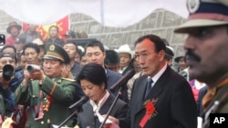Chairman of Tibet Autonomous Region Qiangba Puncog, second right, speaks on the Chinese side at a ceremony to open the Nathu La Pass, in northeastern Indian state of Sikkim, Thursday, July 6, 2006. Indian and Chinese officials reopened a famed Silk Road pass high in the Himalayas 44 years after it was shut by war, in a ceremony Thursday marked by brass bands that sent festive notes swirling into mountain mists. (AP Photo/Gurinder Osan)