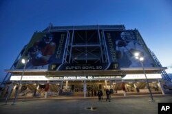 The entrance to Levi's Stadium is decorated with images of Denver Broncos quarterback Peyton Manning, left, and Carolina Panthers quarterback Cam Newton, Feb 2, 2016 in Santa Clara, Calif.