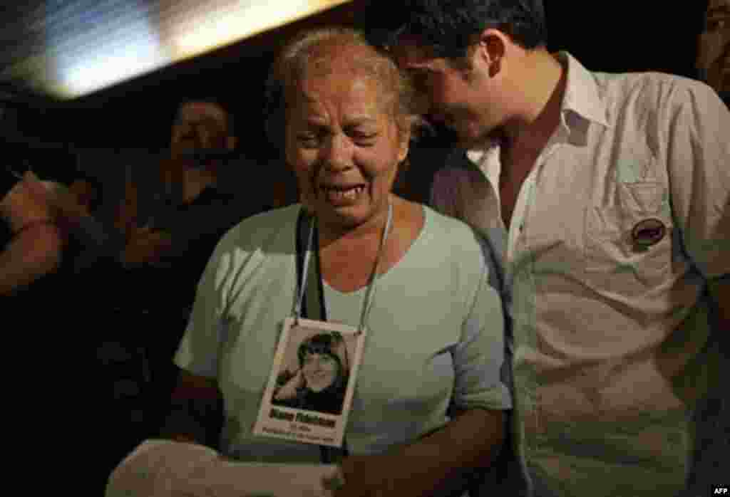 The relative of a victim killed during Argentina's dirty war cries at the end of the trial of former dictator Jorge Videla in Cordoba, Argentina, Wednesday Dec. 22, 2010. Videla was sentenced to life in prison Wednesday for the torture and murder of 31 p