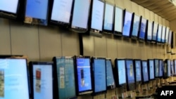 FILE - Flat-screen TV sets on display at a Best Buy store in San Francisco, California.
