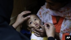 Child receives a polio vaccine in Islamabad, Pakistan, Oct. 16, 2012.