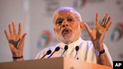 "Indian Prime Minister Narendra Modi addresses people during the launch of a ""Digital India"" project in New Delhi, July 1, 2015."