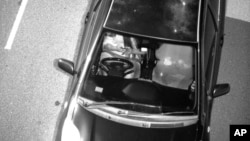This Jan. 12, 2019, photo captured by a Mobile Phone Detection Camera and released by Transport for NSW shows a driver using a mobile phone while driving in Australia.