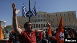 A municipality worker shouts slogans in front of the parliament during a rally against new austerity measures in Athens, October 3, 2012.