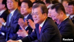 FILE - South Korean President Moon Jae-in attends a business forum in New Delhi, India, July 9, 2018.