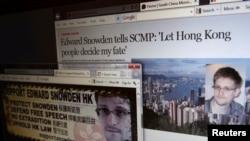Bài phỏng vấn Edward Snowden trên tờ South China Morning Post (trên) và một website ủng hộ Snowden ở Hong Kong. (REUTERS/Bobby Yip)