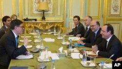 Ο Τζέικομπ Λιου στην συνάντηση του με τον γάλλο Πρόεδρο, Φρανσουά Ολάντ