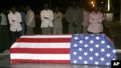 Sudanese men look at the flag-draped coffin of U.S. diplomat John Granville, who worked for the U.S. Agency for International Development. (file)