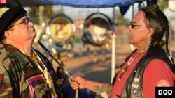 U.S. Marine Corps veteran Antonio Quezada, White Mountain Apache, receives spiritual cleansing and prayer from Native American Veterans Association (NAVA) Spiritual Advisor and Sun Walker, Tony Littlehawk, a member of the Cherokee tribe and an Army Vietna