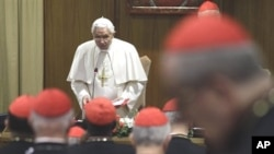 Pope Benedict XVI delivers his message to cardinals at the Vatican, 19 Nov 2010