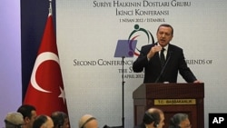 "Turkey's Prime Minister Recep Tayyip Erdogan addresses participants of the ""Friends of Syria"" conference in Istanbul April 1, 2012."