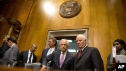 FILE - Senate Foreign Relations Committee Chairman Sen. Bob Corker, R-Tenn., center, speaks with the committee's ranking member Sen. Ben Cardin, D-Md., on Capitol Hill in Washington, April 14, 2015.