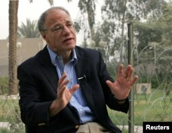 Human Rights Watch director Richard Dicker speaks during an interview in Baghdad's Green Zone, Oct. 19, 2005.