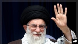 Iran's Supreme Leader Ayatollah Ali Khamenei waves to his supporters before starting his speech in the province of Kermanshah, west of Tehran October 15, 2011. Khamenei said on Saturday U.S. accusations that two Iranians planned to assassinate the Saudi A