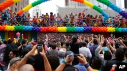 Revelers dance during the annual Gay Pride Parade in Sao Paulo, Brazil, Sunday, May 29, 2016.