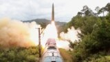 A missile is seen launched during a drill of the Railway Mobile Missile Regiment in North Korea, in this image supplied by North Korea's Korean Central News Agency on September 16, 2021.