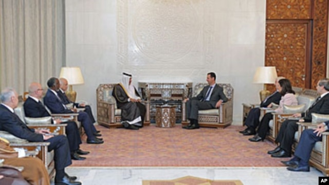 Syrian President Bashar al-Assad, center right, meets with Qatari Prime Minister Sheikh Hamad bin Jassim Bin Jabr al-Thani, center left, Damascus, Oct. 26, 2011.