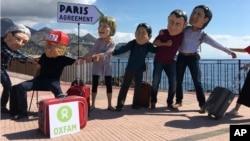 Hình minh họa của Oxfams về các nhà lãnh đạo G-7 với Thỏa thuận Khí hậu Paris 2015.