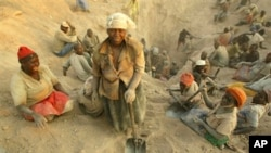 Women miners search for diamonds in eastern Zimbabwe's lucrative Marange diamond fields.