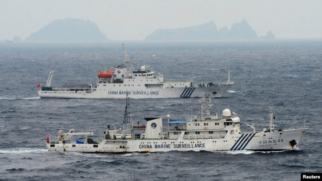 An aerial photo shows Chinese marine surveillance ships Haijian No. 49 (front) and Haijian No.50 cruising in the East China Sea, as the islands known as Senkaku isles in Japan and Diaoyu islands, April 23, 2013.