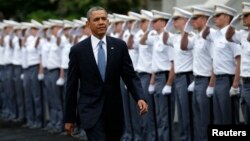 FILE - President Barack Obama attends a commencement ceremony at the U.S. Military Academy in West Point, New York, in 2014.