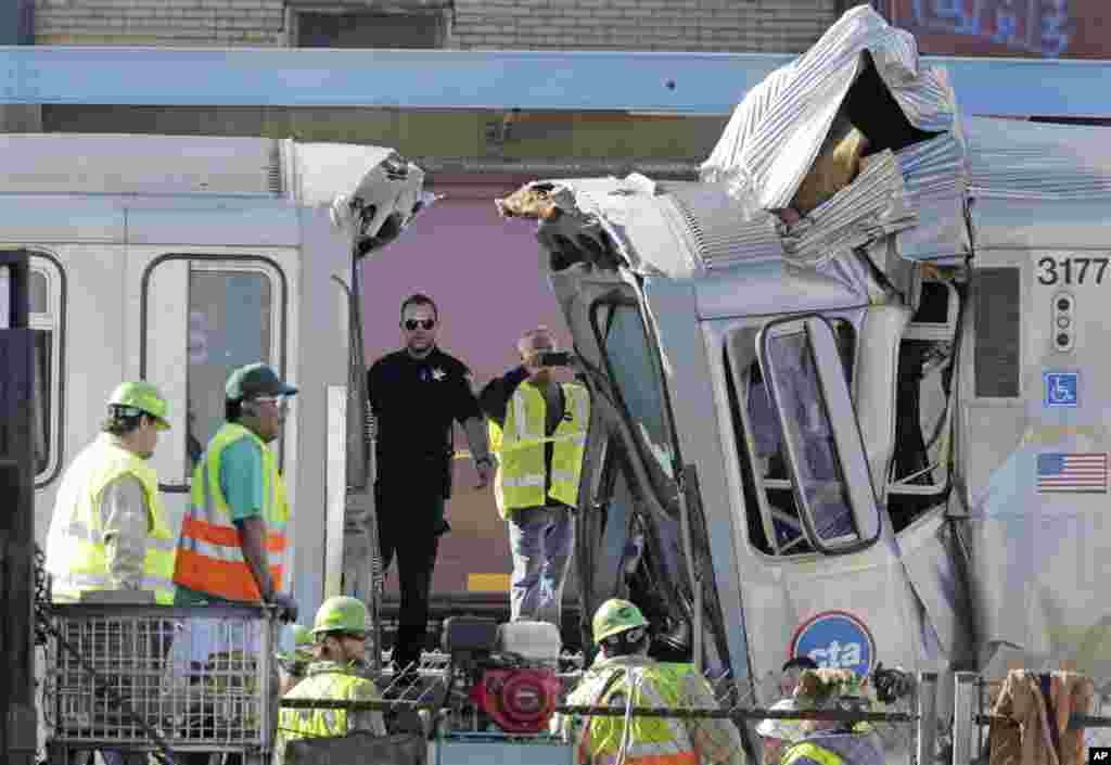 Authorities inspect the wreckage of two Chicago Transit Authority trains that crashed in Forest Park, Illinois. The CTA is investigating the cause of the crash, including why the trains were on the same track. A CTA official said 33 people suffered non-life threatening injuries.