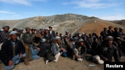 Displaced Afghan villagers gather near the site of a landslide that occurred May 2 at the Argo district in Badakhshan province, May 5, 2014.
