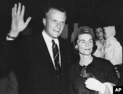 Evangelist Billy Graham, shown with his wife, Ruth, on arrival in London, June 6, 1959.