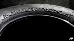 FILE - The Goodyear brand name is molded into the sidewall of a tire at a Goodyear Auto Service Center, in Stoneham, Mass.