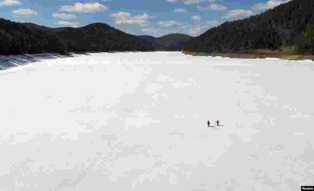 Local residents make their daily trip on spring ice across the Yenisei River to the isolated Siberian Khmelniki village, outside Krasnoyarsk, Russia, April 22, 2019.