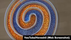 "A screen shot from Hevesh5 showing her ""Amazing Triple Spiral."""