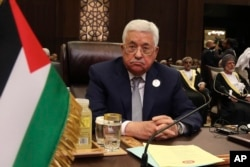 FILE - Palestinian President Mahmoud Abbas attends the summit of the Arab League at the Dead Sea, Jordan, March 29, 2017.