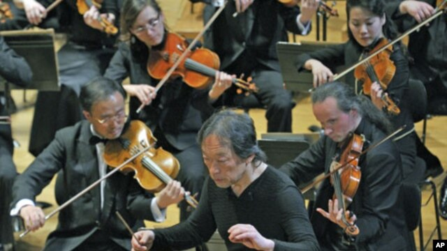 South Korean maestro Chung Myung-whun, director of the Radio France Philharmonic Orchestra, conducts the last rehearsal with North Korea's Unhasu Orchestra and Radio France Orchestra in Paris, March 14, 2012.