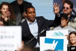 FILE - Joe Neguse, seen here at a rally with young voters on the campus of the University of Colorado, Oct. 24, 2018, was among the U.S. lawmakers who visited Eritrea.