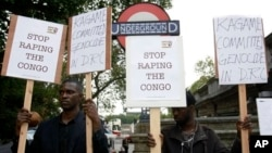 Protesters stand outside Arundel House where President of the Republic of Rwanda, Paul Kagame, deliverers the annual Oppenheimer Lecture, London, Sept. 16, 2010.