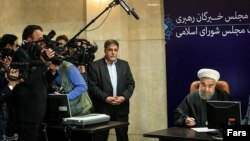 Iran's President Hassan Rouhani, who is also a member of the Experts Assembly, speaks with the media in a press briefing after registering his candidacy for the Feb. 26 elections of the assembly at interior ministry in Tehran, Iran, Monday, Dec. 21, 2015.