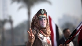 An Egyptian woman wears a mask of Egypt's Defense Minister Gen. Abdel-Fattah el-Sissi in Tahrir Square, in Cairo, Egypt, Jan. 25, 2014.