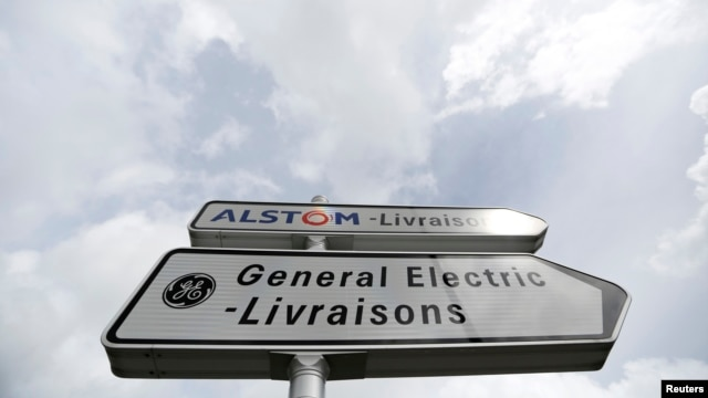 Road signs indicate directions for deliveries to French power and transport engineering company Alstom and U.S. conglomerate General Electric, Belfort, France, April 27, 2014.