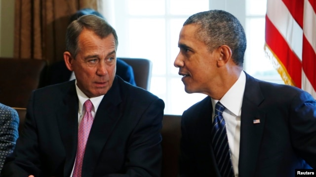 Speaker of the House John Boehner (R-OH) left, talks to U.S. President Barack Obama during a meeting with bipartisan Congressional leaders, Sept. 3, 2013.