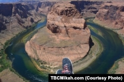 From the edge of a mesa above the Colorado River, it's easy to see how Horseshoe Bend got its name.