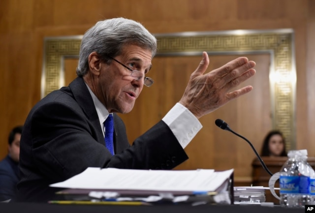 FILE - Secretary of State John Kerry promises a decision soon on whether the Islamic State is committing genocide.