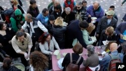 Soup kitchen volunteers hand out food in central Athens, which has seen high unemployment and a steady decline in living standards for most Greeks, April 25, 2017.