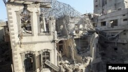 An Ottoman-era building damaged by an air strike at a besieged area in Homs, November 28, 2012.